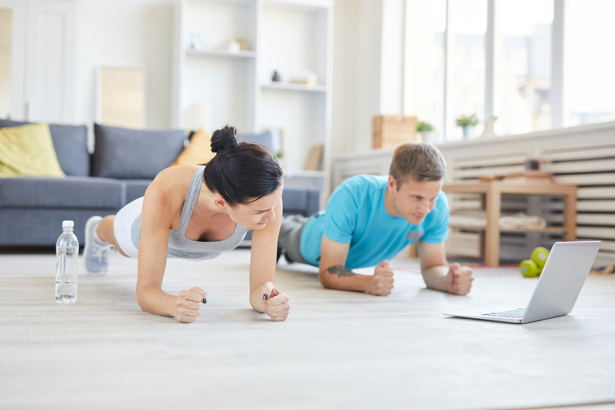 Man and woman working out in living room