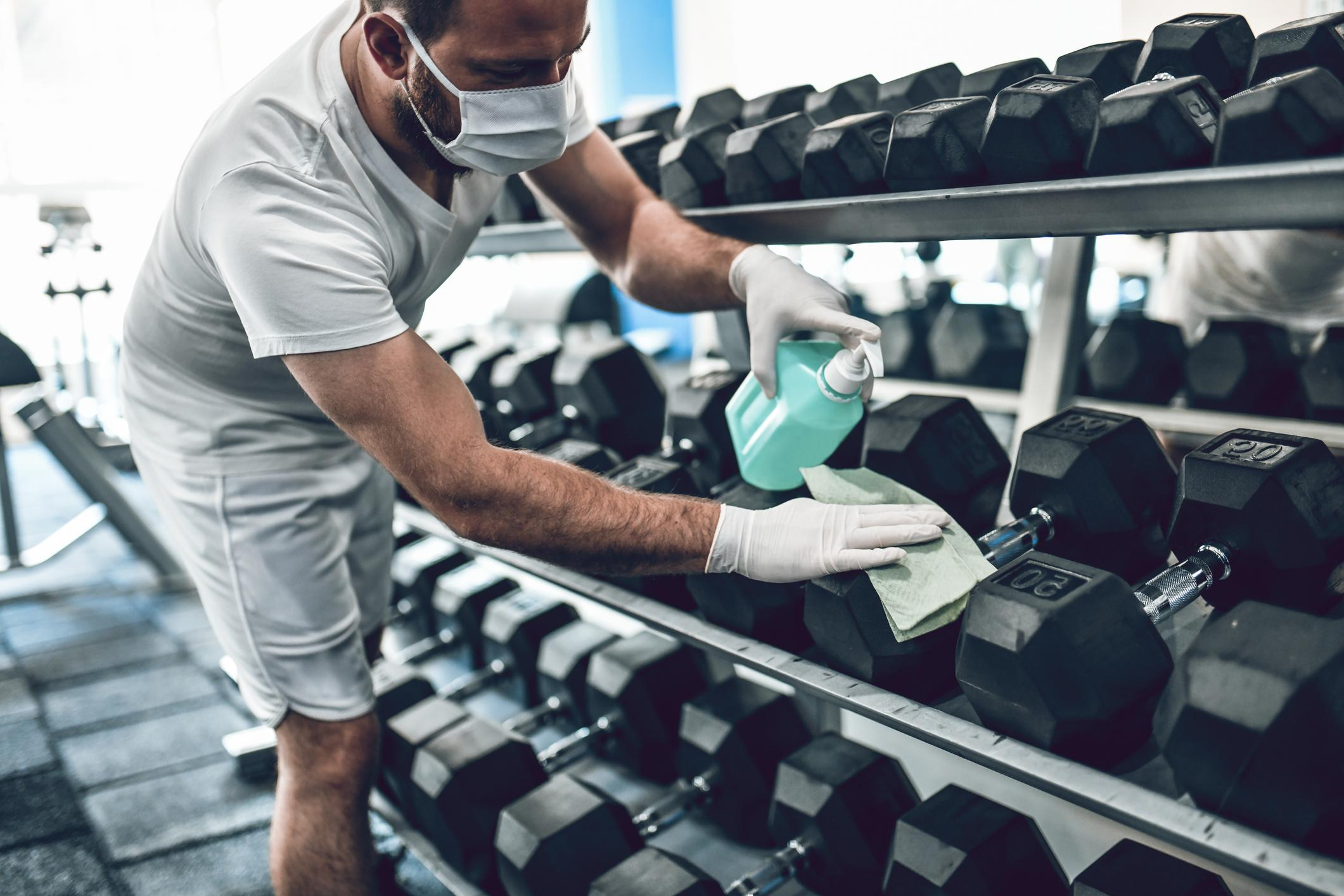 Man cleaning dumbells